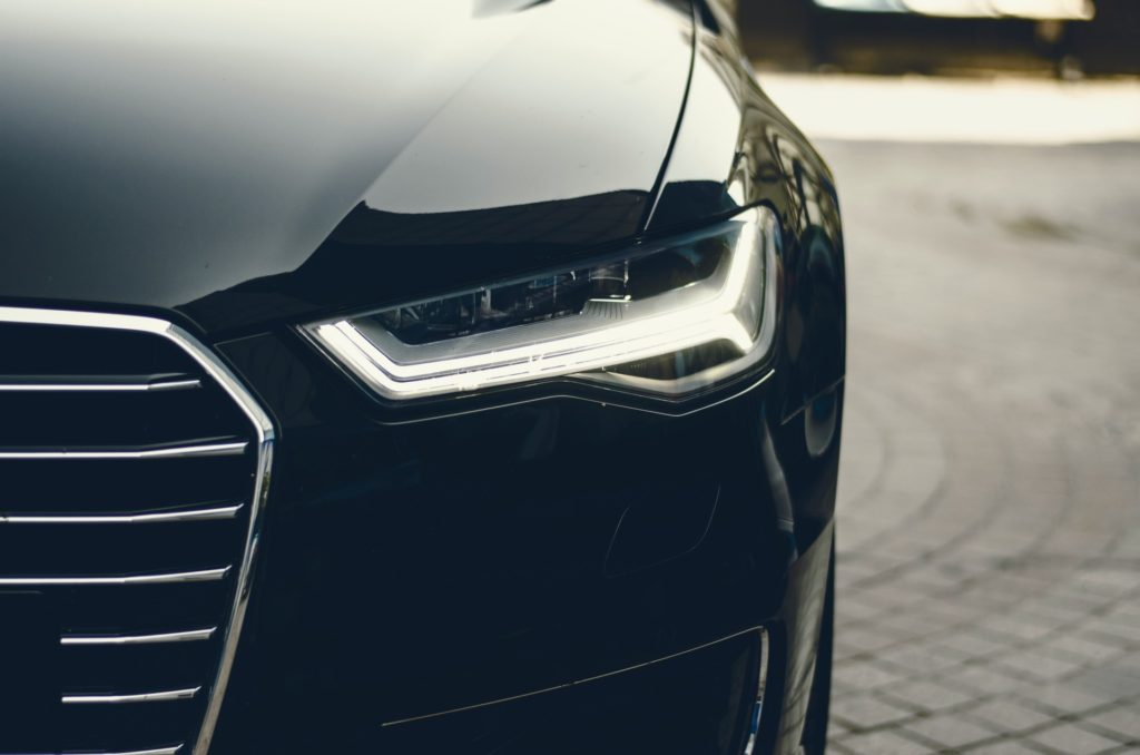 Closeup black car's headlight