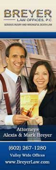 Mark and Alexis Breyer holding their injury guide book