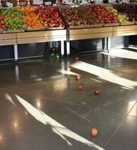 grocery store with apples on the floor