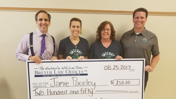 Attorney Mark Breyer; Jaime Paceley, August's Teacher Appreciation winner; assistant principal Kaity Harris; and principal Tim Fountain, posing with Jaime's giant check!